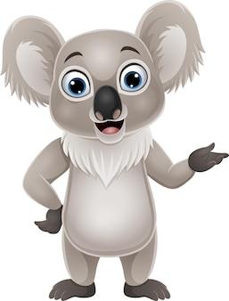 Dessin animé koala heureux présentant sur blanc