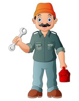 Dessin animé un mécanicien masculin tenant une clé et une boîte à outils