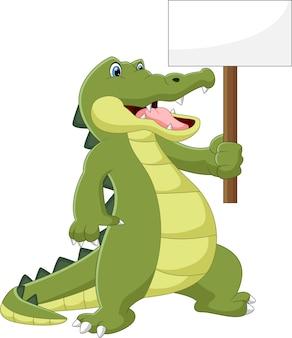 Dessin animé mignon crocodile tenant une pancarte blanche