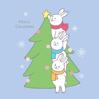 Dessin animé mignon lapins de noël décorant un arbre de noël