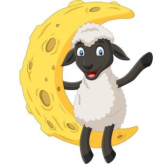 Dessin animé mignon mouton assis sur la lune