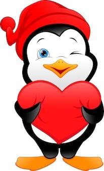 Dessin animé mignon de pingouin tenant signe d'amour