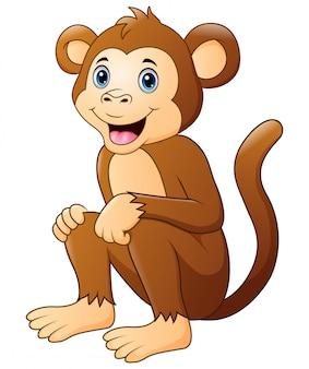 Dessin animé mignon singe assis et souriant