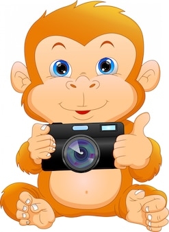 Dessin animé mignon singe tenant la caméra