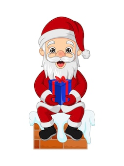 Dessin animé père noël dans une cheminée tenant un cadeau