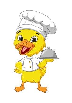 Dessin animé petit chef caneton jaune tenant un plateau d'argent