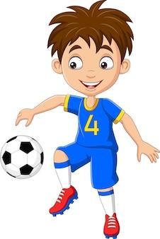 Dessin animé petit garçon jouant au football