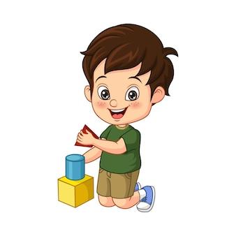 Dessin animé petit garçon jouant avec des cubes