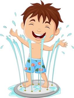 Dessin animé petit garçon jouant à la fontaine d'eau