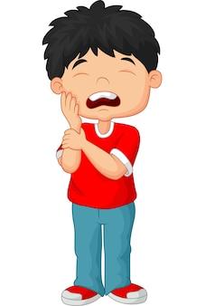 Dessin animé petit garçon mal aux dents