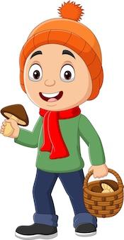 Dessin animé petit garçon avec panier de champignons