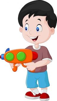 Dessin animé petit garçon tenant pistolet à eau