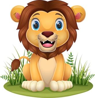 Dessin animé petit lion assis dans l'herbe