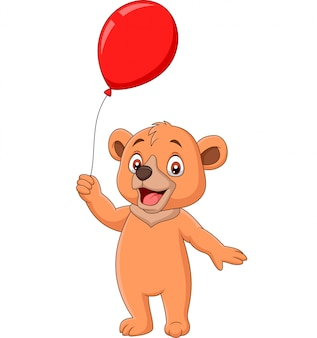 Dessin animé petit ours tenant un ballon rouge