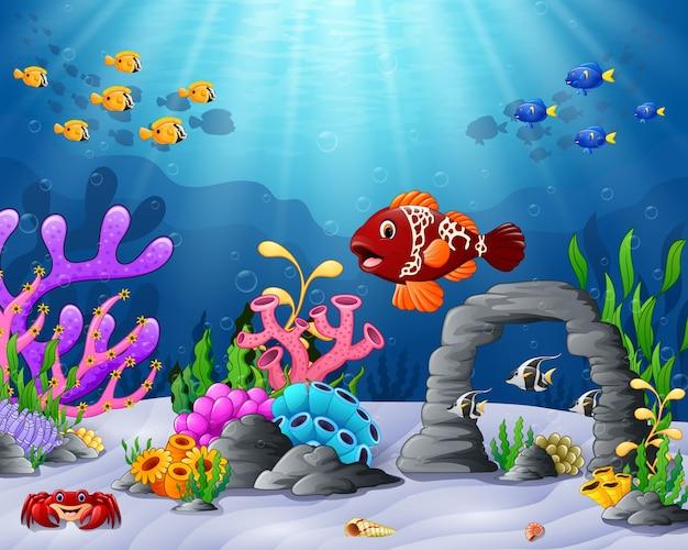 Dessin animé poissons tropicaux avec un beau monde sous-marin