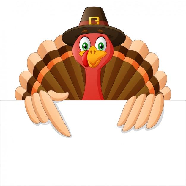 Dessin animé thanksgiving turquie oiseau mascotte personnage tenant une pancarte blanche