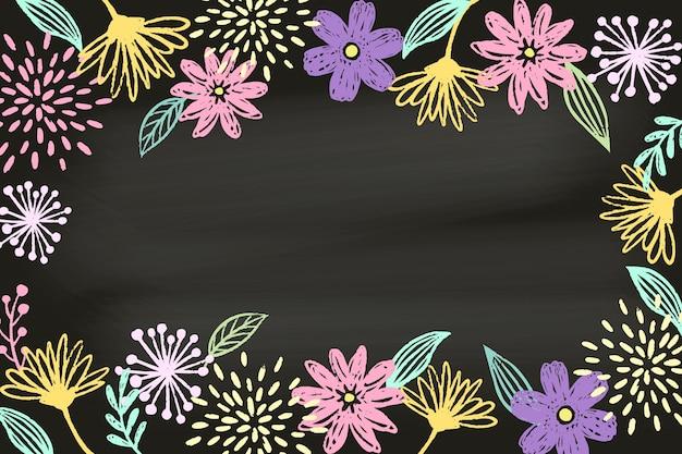 Dessin avec des fleurs sur fond d'écran tableau noir