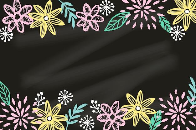 Dessin avec des fleurs sur fond de tableau noir