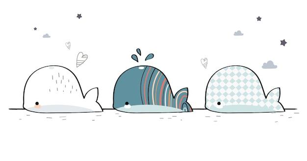 Dessin à la main mignon famille baleine doodle de bande dessinée de voeux