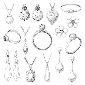 Dessiné à la main un ensemble de bijoux différents. d'un style de croquis.