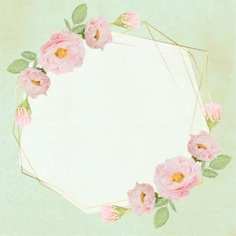 Dessiner à la main des roses roses aquarelles avec une couronne de cadre doré sur fond grunge