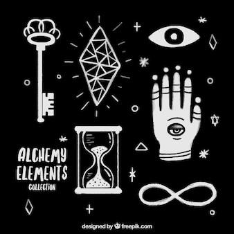 Dessinés à la main les accessoires d'alchimie et les symboles fixés
