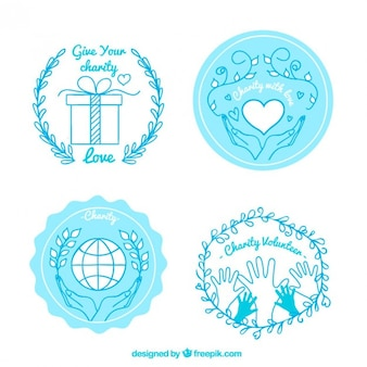 Dessinés à la main badges de charité, couleur bleue