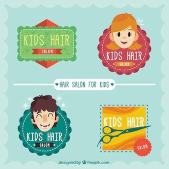 Dessinés à la main les enfants de logotypes salon de coiffure