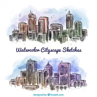 Dessinés à la main des villes d'aquarelle avec des gratte-ciel