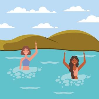 Dessins animés de filles avec maillot de bain dans la mer devant la conception de vecteur de montagnes