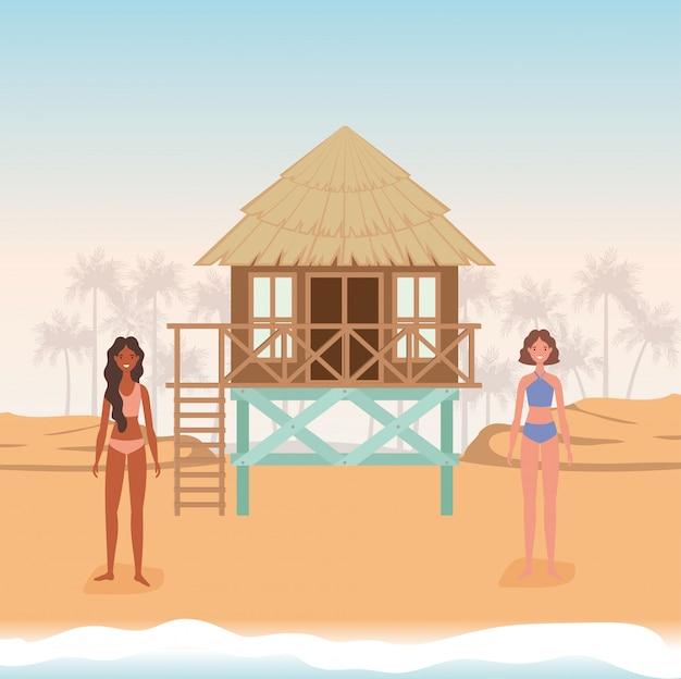 Dessins animés de filles avec maillot de bain à la plage avec conception de vecteur de hutte
