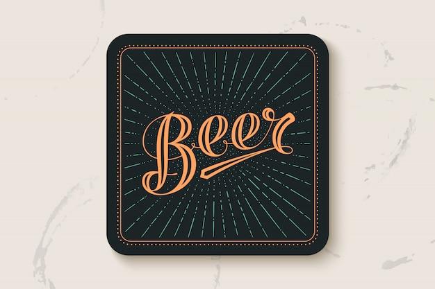 Dessous de verre avec lettrage dessiné à la main bière