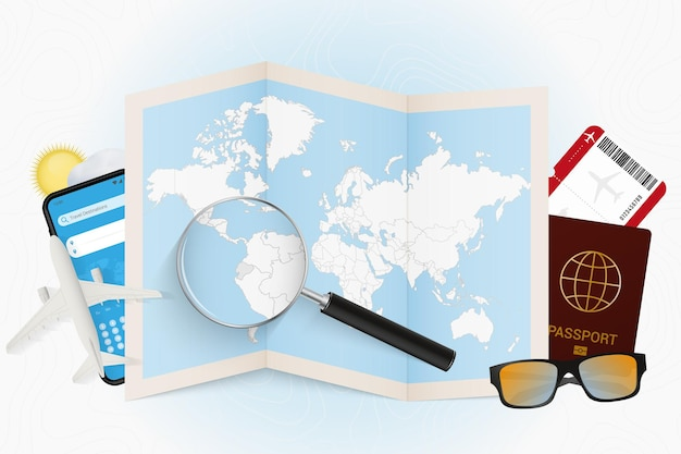 Destination de voyage équateur, maquette touristique avec équipement de voyage et carte du monde avec loupe sur un équateur.