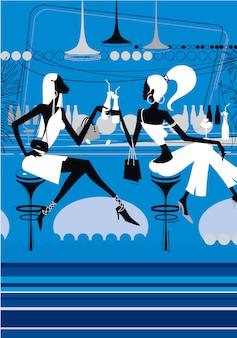 Deux belles filles boivent des cocktails dans un club de nuit.