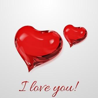Deux coeurs rouges sur fond blanc avec inscription je t'aime