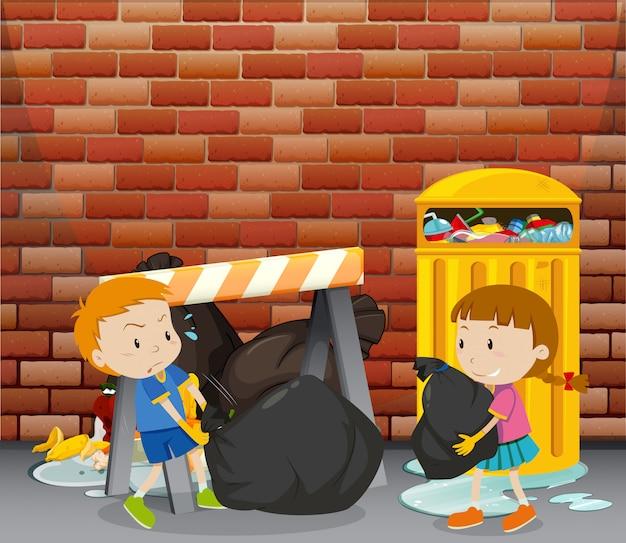 Deux enfants déversant des ordures près de la poubelle