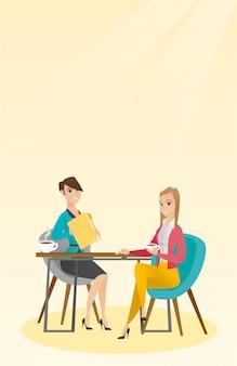 Deux femmes d'affaires lors d'une réunion d'affaires.