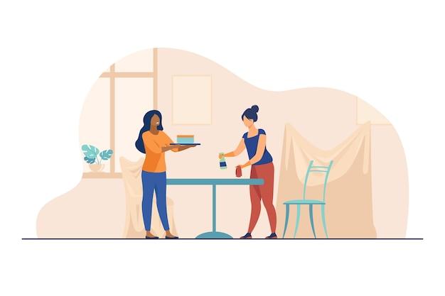 Deux femmes nettoyant la table et la chambre.