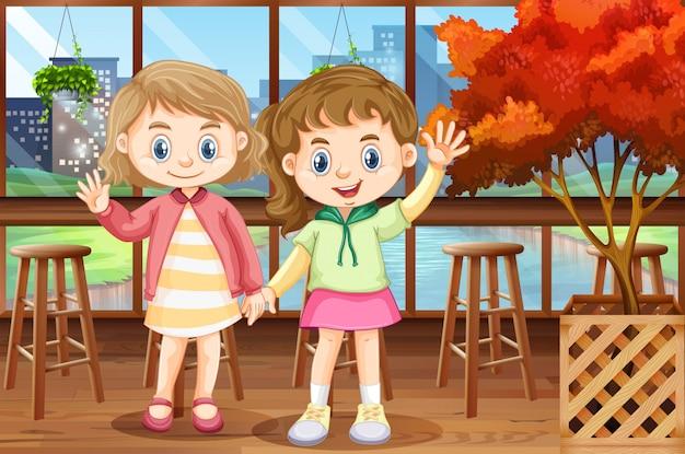 Deux filles heureuse au restaurant