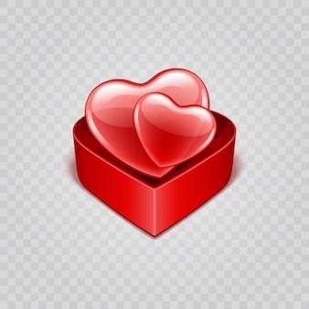 Deux formes de coeurs brillants rouges dans une boîte cadeau isolée sur l'illustration de la transparence