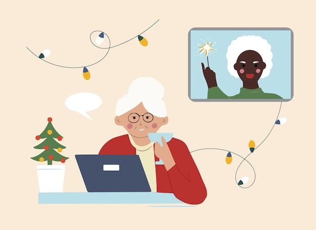 Deux grands-mères âgées se souhaitent un joyeux noël en ligne