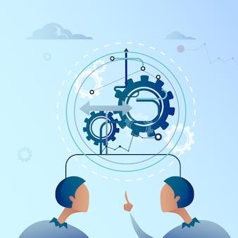 Deux, homme affaires, point, doigt, sur, cog wheel, homme affaires, processus, de, brainstorming