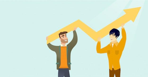 Deux hommes d'affaires multiraciales tenant graphique de croissance.