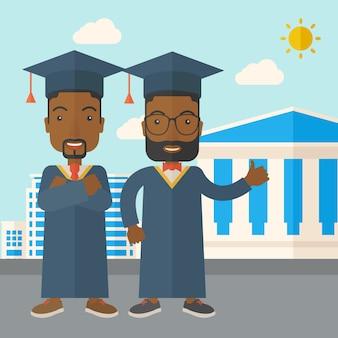 Deux hommes noirs portant une casquette de graduation.