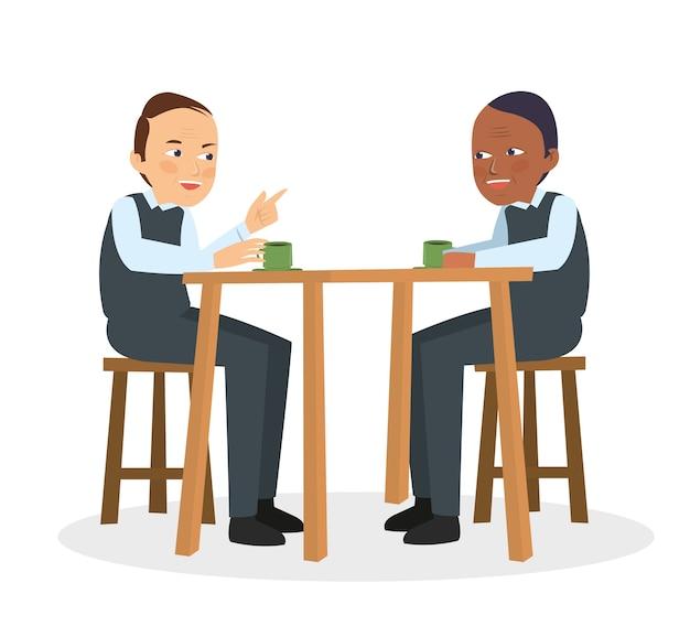 Deux mecs parlent et discutent au café