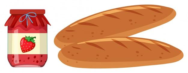 Deux miches de pain et pot de confiture de fraises