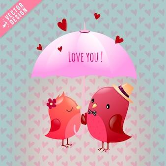 Deux oiseaux amoureux sous un parapluie rose