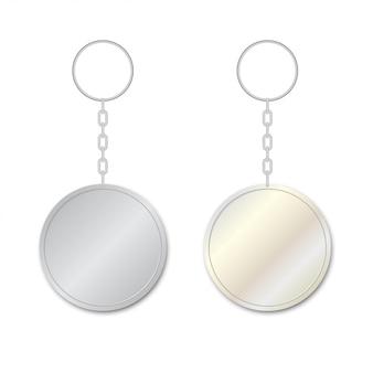 Deux pendentifs porte-clés métalliques.