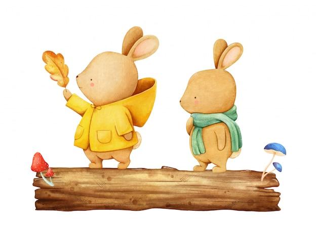 Deux petits lièvres heureux sur une poutre aux champignons. illustration aquarelle peinte à la main
