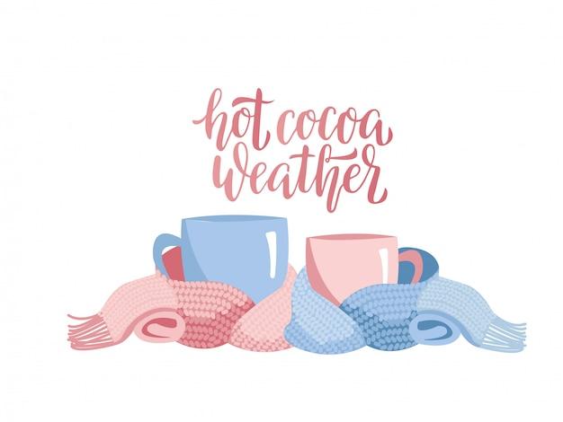 Deux tasses en écharpe tricotée.